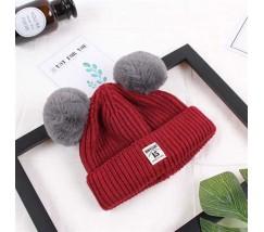 Зимова дитяча шапка з помпончиками бордо