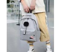 Женский тканевый рюкзак с помпоном серый