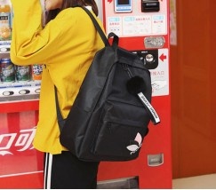 Женский тканевый рюкзак с помпоном черный