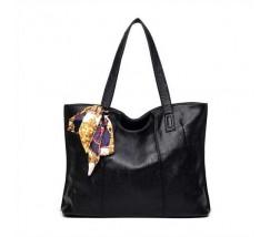 Женская сумка черная с длинными ручками и ленточкой