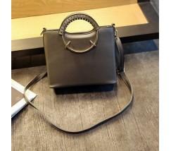 Елегантна жіноча сумка з круглими ручками сіра