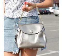 Женская сумка из натуральной кожи с пуговкой серебристая