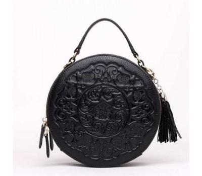 Женская круглая сумка кросс-боди черная кожаная с рисунком