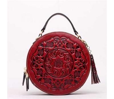 Женская круглая сумка кросс-боди красная кожаная с рисунком