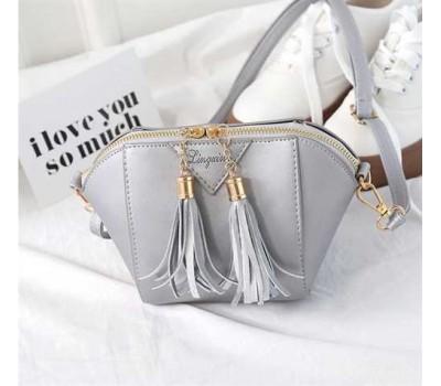 Женская сумочка маленькая серая с кисточками