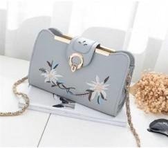 Женская сумочка клатч с вышивкой серая