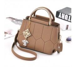 Красивая сумка с брелком коричневая