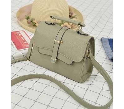 Модная маленькая женская сумочка зеленая