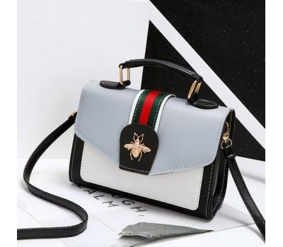 Модная женская сумка с застежкой шмеля серая