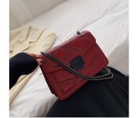 Жіноча сумка з декором червона