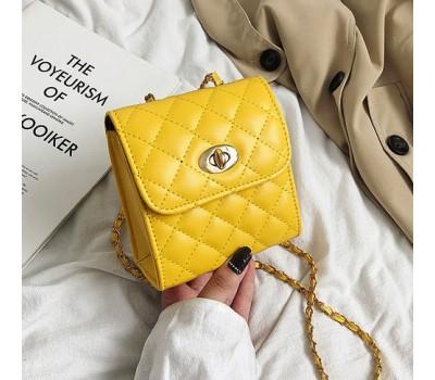Маленькая сумочка клатч желтая