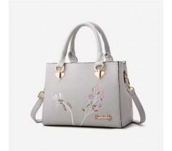 Красивая женская сумка с цветами серая