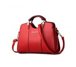 Елегантна жіноча сумка червоного кольору