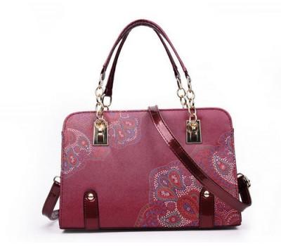 Красивая сумка с узорами бордовая