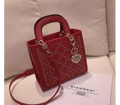 Каркасная женская сумка с узором красная