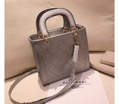 Каркасная женская сумка с узором серая