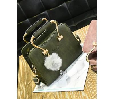 Красивая каркасная женская сумка зеленая