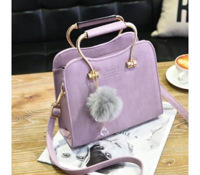Красивая каркасная женская сумка сиреневая